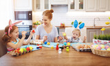 Happy easter! family mother and children paint eggs for   holiday - 194657710