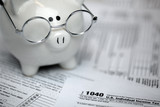 US Tax forms with piggybank - 194663922