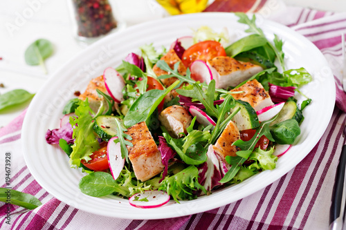 Fresh vegetable salad with grilled chicken breast   - tomatoes, cucumbers, radish and mix lettuce leaves. Chicken salad. Healthy food. - 194673928