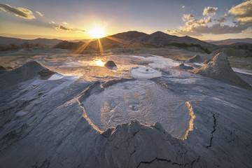 sunset behind the muddy volcanoes