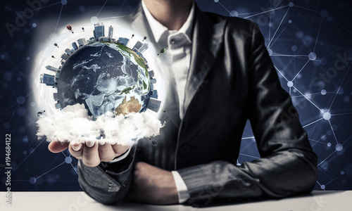 Businessman presenting Earth globe. - 194684122