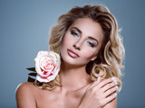 Photo of a beautiful  blond woman with flower