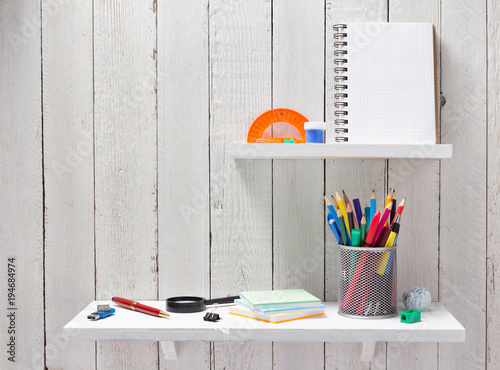 Poster school supplies and tools at  wooden shelf