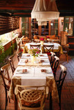 Retro designed restaurant with setting tables - 194690322