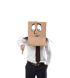 businessman with cardboard box on his head showing thumb down isolated on white - 194698110