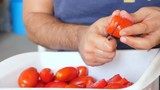man's hand cutting fresh tomatoes- South of Italy - 194699142