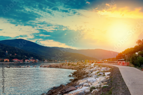 Fotobehang Zwavel geel Sunset landscape in Bocca Di Magra, Italy