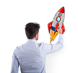 Businessman Drawing A Rocket Concept Of Business Improvement And Enterprise Startup Wall Sticker