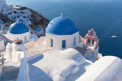 Idyllic view on traditional church rooftops of Santorini