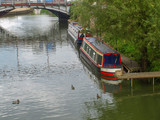 River view with mooring narrowboats and a bridge in Tewkesbury in Gloucestershire, Great Britain. - 194718376