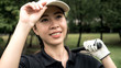 Quadro Asian woman golfer hitting golf in cap and sunglasses playing golf