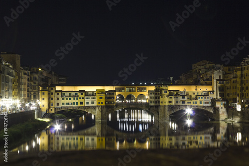 Aluminium Florence Night view of the historic Ponte Vecchio bridge in Florence on Arno river