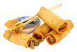 Chinese crispy duck filled spring rolls with soy sauce dip isolated on a white background