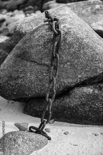 Chain in rock black and white