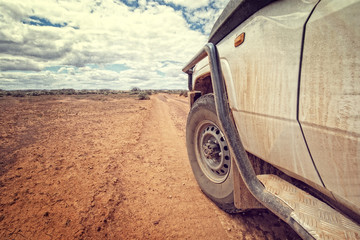 South Australia – Outback desert with 4WD on track under cloudy sky - vintage