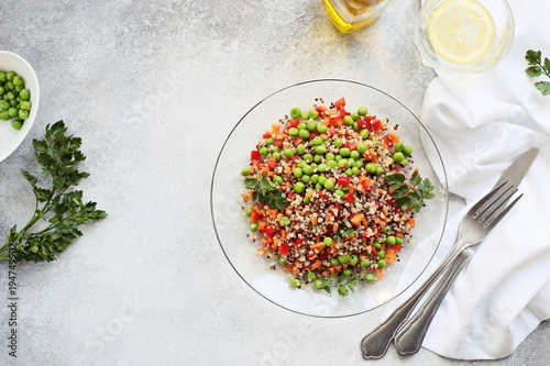 Papiers peints Buddha Quinoa salad with green peas, carrot, paprika and greenery. Spring detox salad with quinoa and fresh vegetables. Super food and clean eating concept