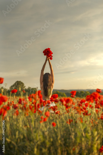 Fotobehang Klaprozen a girl on a poppy field