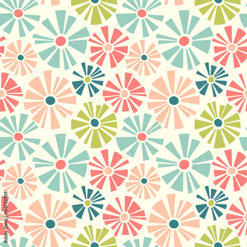 Spring theme seamless pattern of cut out style daisies. Cheerful retro design for fabric, wallpaper, backgrounds and decor.