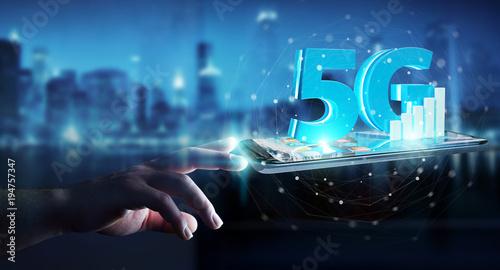 Staande foto Wanddecoratie met eigen foto Businessman using 5G network with mobile phone 3D rendering