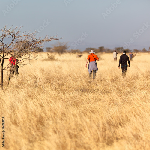 Tuinposter Beige in the national park tourist looking for wild animals
