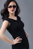 Young beautiful woman in black dress and sunglasses - 194801910