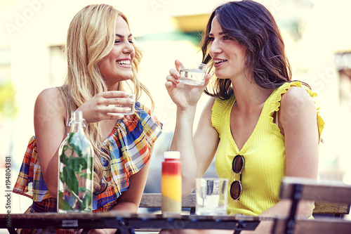 Foto op Canvas Sap Beautiful Young Women Having Fun in Coffe