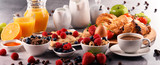 Breakfast served with coffee, juice, croissants and fruits - 194806906