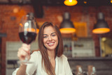 Young smiling girl with a glass of wine - 194810912