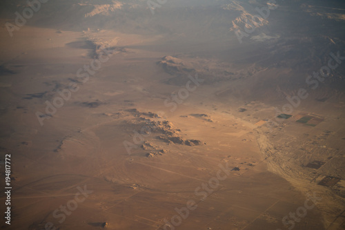 view from plane during flight over California mountains in sunset - 194817772