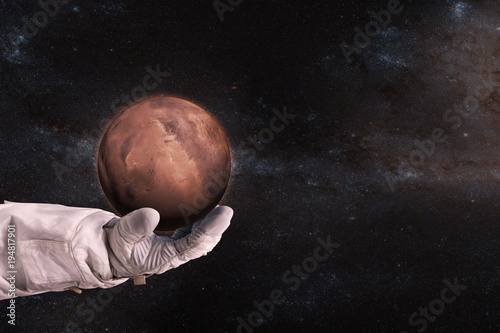 Fotobehang Nasa Mars in the hands of astronaut. Elements of this image furnished by NASA.
