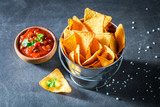 Tasty nachos with spicy red sauce and salt - 194819512