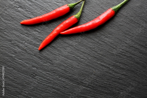 Foto op Canvas Hot chili peppers Red chili pepper on slate board