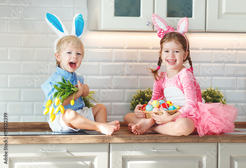 Happy easter! funny funny children l with ears hare getting ready for holiday