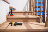 Manufacturing, repair of wooden stairs in a residential building.