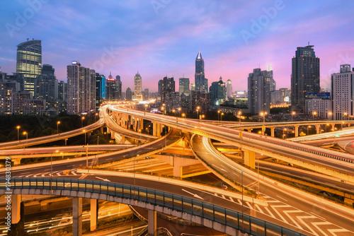 Tuinposter Nacht snelweg Beautiful Shanghai city with interchange overpass at nightfall in Shanghai, China.