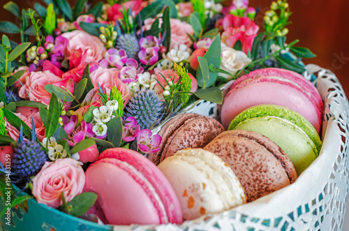 Macaroons in gift box with flowers Poster