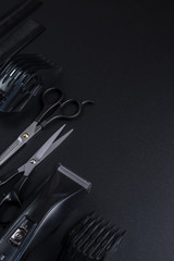 tools for cutting hair on a black background
