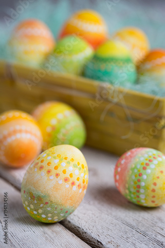Painted Easter eggs on old boards , Easter background - 194834566