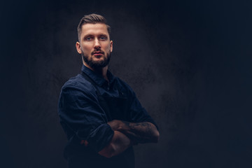 Studio portrait of a professional bearded butcher with hairstyle