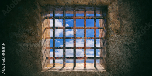 Prison, jail rusty window and blue sky view on old wall background