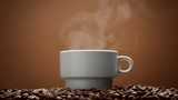 white cup on coffee beans with steam from hot drink. - 194858353