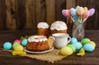 Easter cake and colorful eggs on a wooden table. It can be used as a background