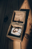 Golden rings of the newlyweds in a wooden box. - 194862536