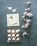 Easter greeting layout composing with eggs, blossom and blank card mock up on gray background, top view, flat lay - 194868760