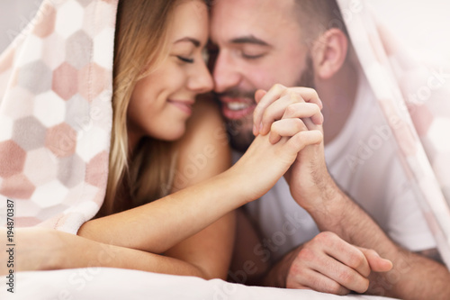 Adult attractive couple in bed - 194870387