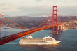 Golden Gate Bridge with cruise ship at sunset, San Francisco, California, USA