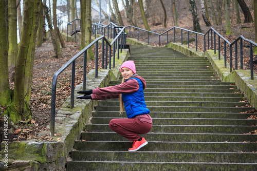 Foto op Canvas Jogging Woman wearing sportswear exercising outside during autumn