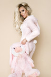 Beautiful sexy blonde woman wearing a pajama, a bunny costume, smiling happily. Fashion model on a beige background in  Easter bunny costume. - 194883396