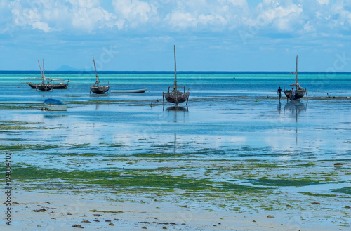 Deurstickers Zanzibar Fishing boats during outflow in Nungwi. Zanzibar in Tanzania., Africa, February 2018.