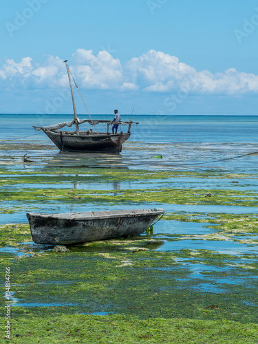 Fotobehang Zanzibar Fishing boats during outflow in Nungwi in Zanzibar. Tanzania, Africa, February 2018.
